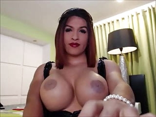 TS In Stockings Cumming On Her Enormous Boobs