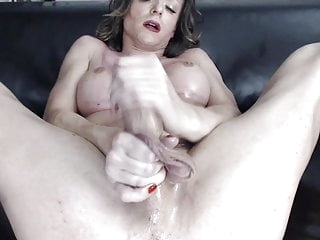 German tranny jerks her cock till she cums