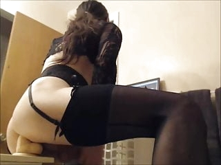 Plugged ass shemale in stockings cumming on her hands