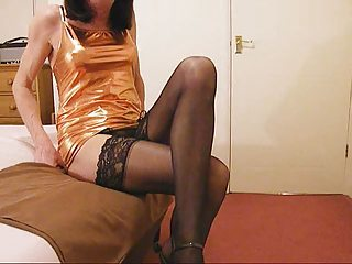 Tranny in stockings sprays cum everywhere
