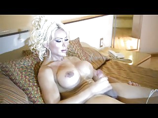 Busty Blonde Strokes Her Cock