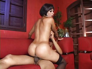 Horny guy on his knees sucks on a tranny cock