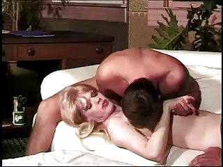 Blonde Tranny Takes Care of Three Studs