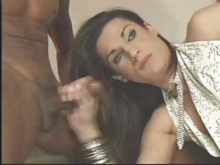 Transsexual brunette gives two guys a blowjob