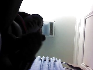 Ebony TG stroking huge cock in bathroom