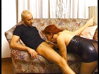 Redhead hot tranny sucks on guys cock on the sofa