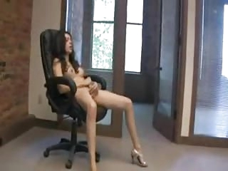 Brunette jerks and cums in the office