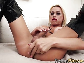 Busty tranny fingers herself while jerking off