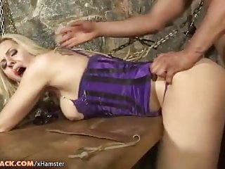 Blonde tranny in purple corset gets fingered and fucked