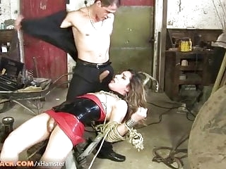 Small cock tranny in latex dress gets fucked in bondage