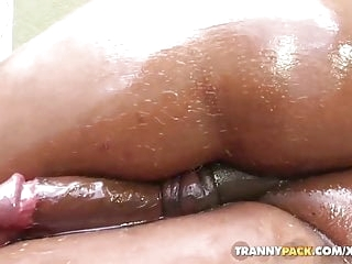 Brunette tranny w huge ass gets oiled up 'n jerks off by the